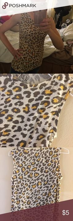 Sleeveless Animal Print Shirt-SMALL This sleeveless top is funky and fun. It can be dressed down and paired with some jeans or paired with a pencil skirt and blazer for an office look. It's light and great for spring and summer. No flaws or stains. Nonsmoking home. Well Worn Tops Blouses
