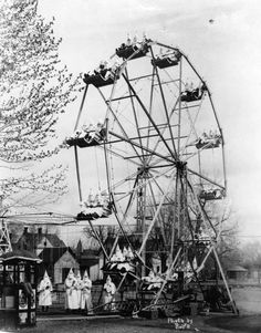 The Ku Klux Klan on a ferris wheel, 1928   Hate goes to the fair.....scary when you think about it