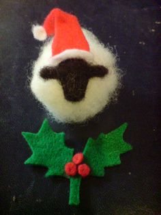 5e2665a70b7a7 2 Needle felted Christmas sheep in santa hats by SheepInStitches