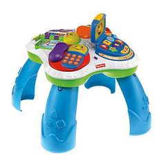 FISHER-PRICE LAUGH & LEARN FUN WITH FRIENDS MUSICAL TABLE (W/COUPON CODE: 955386) This Bi-lingual activity table from Fisher-Price features interactive characters to encourage baby's learning and play. Characterized light-up faces on activities encourage baby to cruise around the table. Each character has a unique personality to interact with baby. After baby stops playing with one activity, another activity will light up and speak to baby encouraging him to move around the table. Laptop open...