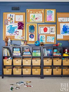 Make a gallery wall of cork boards for fun art storage and display. This gives kids a space to show off their work and keeps finished projects off surfaces. Spray-paint bins the same shade and slide into a cube storage unit for a cohesive look. Art Storage, Cubby Storage, Craft Room Storage, Storage Ideas, Kids Clothes Storage, Craft Organization, Organizing Crafts, Boy Room, Entertainment Center