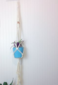 Cotton Macrame Plant Hanger, Hanging Planter, Copper Plant Hanger, Plant Holder. Show your plants some love with this modern, vintage-inspired macrame plant hanger. Simple, yet meticulously hand-crafted, this beauty would be equally at home gracing a living room corner, or brightening up an office. Designed with 100% white/cream cotton rope sourced locally within Ontario, this lovely plant hanger is a stylish way to showcase your favorite plants year-round. Suitable for both indoor and...