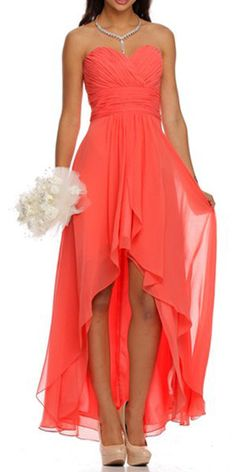 Perfect for a bridesmaid dress, this high low dress in coral flaunts a strapless look that is nicely complemented by a sweetheart neckline. A charming ruching pattern graces the fitted bodice in an ov