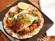 Breakfast tacos made with crispy potatoes fried in chorizo fat, and a fried egg