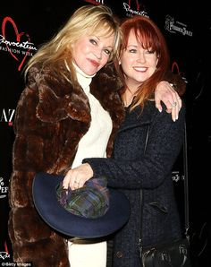 Sister act: She also posed up with sibling Tracy Griffith at the Harper's event...