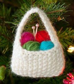 This knit Christmas ornament is the ultimate gift for any yarn lover. Adorn your tree with your passion for knitting with this Yarnie Ornament.