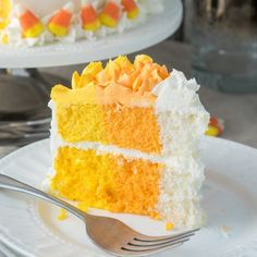 Wow all your friends and family this Halloween with this super easy Candy Corn Layer Cake! Each slice is a masterpiece!