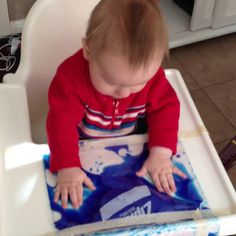 Easy sensory play for babies - ziplock bag+water+food coloring+tape.