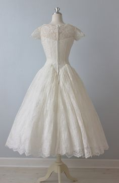 "Damn 50s brides and their 20"" waists!"