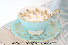 Featuring an Aynsley turquoise & gold gilt hand painted teacup and saucer. Produced by Royal Aynsley in England, our exquisite saucer has a luscious turquoise background, decorated with gorgeous gilt filigree patterns, and the cup on a crisp white bone china background. Reflecting Aynsleys true beautiful craftsmanship. She pings like a bell! Layaway is available. Aynsley is one of the best-known names in the Staffordshire Potteries, with a history reaching back to the late eighteenth cen...