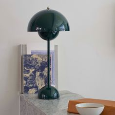 &Tradition's Flowerpot table lamp is a design classic from created by Verner Panton. The joyful lamp was inspired by peace, love and age of Flower Power, and it became a true design icon soon after its launch.