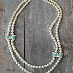 Pearls and Bows Necklace | AllFreeJewelryMaking.com
