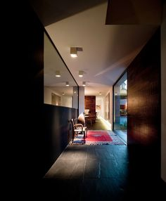 Imposing Black Tiled Flooring And Pure Black Walling With Wall Mirror