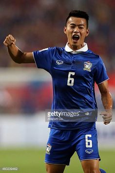 Sarach Yooyen of Thailand celebrates after his assisted goal by Chanathip Songkrasin during the 2014 AFF Suzuki Cup semi final 2nd leg match between...