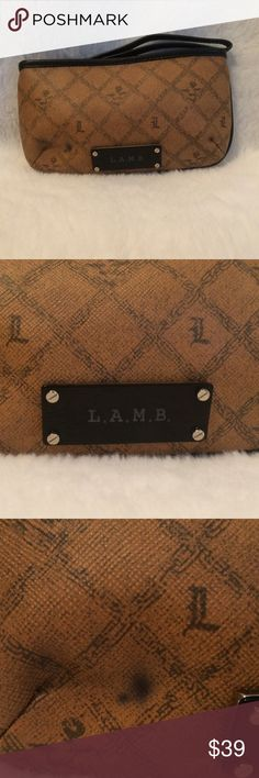 0️⃣ L. A. M. B Brown & Black Wristlet L. A. M. B Brown & Black Wristlet Authentic. I Used This As My Car Makeup Bag & in Doing So It Got a Dark Spot From Leaning/Resting on Something Dark & The Ink Transferred Onto The Wristlet. See 3rd Picture.  0️⃣ Sale. Final Markdown. No Further Discount Taken. L.A.M.B. Bags Clutches & Wristlets