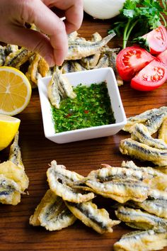 Fried anchovies with lemon parsley dipping sauce. Never seen fresh anchovies before so maybe sub with fresh sardines