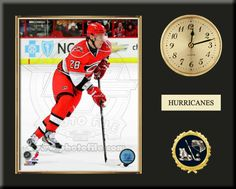 One 8 x 10 inch Carolina Hurricanes photo of Alexander Semin inserted in a gold slide-in frame and mounted on a 12 x 15 inch solid black finish plaque.  Also features a 3-inch Arabian gold-faced clock, a customizable nameplate* and a 2-inch hockey medallion with a gold base.  $59.99 Alexander Semin