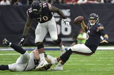 Chicago Bears quarterback Jay Cutler (6) is tripped up by Houston Texans…