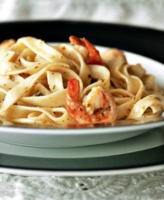 This simple and straightforward pasta recipe can be whipped up on a moments notice with pantry ingredients and shrimp - just the thing for a busy week night supper. Olive oil plays a big role here, so use only the best extra virgin olive oil you can find. Recipe courtesy of a CooksRecipes e-mail I received.  YUM!
