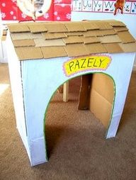 I can make the photo booth backdrop out of a 2D cardboard dog house like this!