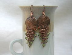 Chainmaille and Hammered copper earrings with green peridot dangles and lily of the valley, BOHO, Handmade, etsy, 50 usd