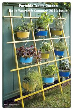 Garden Trellis Vertical Container Garden: Make a large trellis to showcase hanging plants or elevate herbs.Trellis Vertical Container Garden: Make a large trellis to showcase hanging plants or elevate herbs. Jardim Vertical Diy, Vertical Garden Diy, Vertical Gardens, Small Gardens, Outdoor Gardens, Vertical Planting, Hanging Gardens, Hanging Pots, Easy Garden
