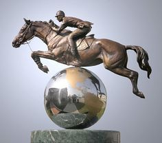 Top Of The World - World-class competitors, this horse and rider are suspended above a stainless steel globe. This sculpture portrays the joy of competition along with the effort that goes into becoming the very best.