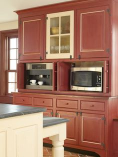 Love this old red color and the style of this cabinetry Farmhouse Kitchen by Timeless Kitchen Cabinetry