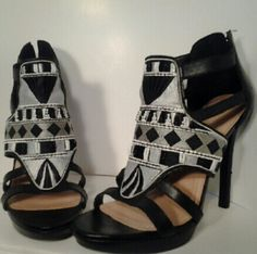 BCBGeneration black tribal platform heels 8 1/2 Worn once! Very clean!  Black, grey,  white tribal beading. Back zipper. All beads intact. 1 nch platform, 5 inch heel. Price is firm. They have been lowered from the original listing price of $45. BCBGeneration Shoes Heels