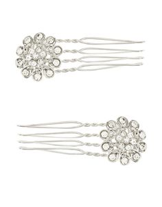 This set of two hair combs are ornamented with crystal gem-encrusted flowers, creating a decidedly vintage look. Slide them into an up-do for subtle sparkle.