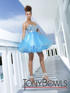 Strapless sweetheart short tulle full A-line dress with Empire bodice featuring large sequins and prisms. Removable straps included.