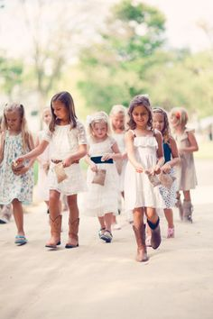 Country Wedding Flower Girl Dress and Cowboy Boots. Now that's cute.