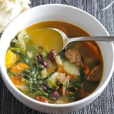 The Best Portuguese Kale Soup is a delicious way to enjoy healthy kale! Sausage, beans and potatoes simmer with kale and plenty of garlic for a hearty soup.