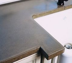 The mixture of this more 'industrial' counter top with a more traditional cabinet is a great look