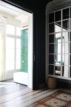 Set in the Praktik Rambla Hotel in Barcelona, this black hall serves as the perfect frame to an adjoining green tiled bath. Photo courtesy of Petite Passport.