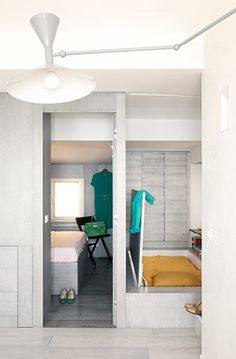 GoPlans designed the second bed in this small home in Camogli, Italy so that it closes up to create floor space during the day (I'm assuming...
