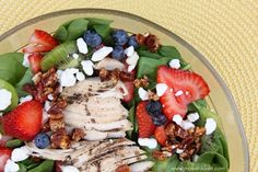 Spinach and Fruit Summer Salad:  10 oz bag of fresh spinach  1-2 chicken breasts, grilled and thinly sliced  1 pint of strawberries, sliced  1 pint of blueberries  1 pint of rasberries  3/4 cup chopped pecans  1/4 cup splenda  4 oz brie cheese or cream cheese, cut in tiny cubes  Dressing:  Rasberry vinagrette or  Your favorite jam mixed with coconut oil or light oil of choice