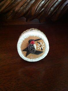 A porcupine quill basket by Brenda Besita.