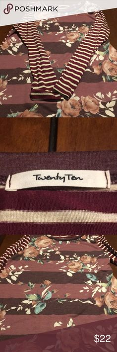 BNWOT trendy purple red floral striped tunic soft! Received this in a mystery bag on 11/29/17 and it's just not my style. This has never been worn and arrived without tags from an online boutique. It's incredibly soft! and has a very cute contrasting stripe pattern. The back is like a burgundy and off white while the front is is a deep plum and light purple with flowers. twenty ten Tops Tunics