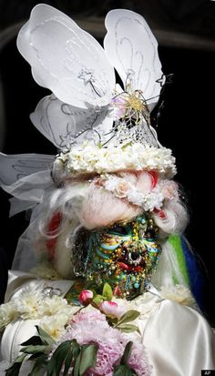 Elaine Davidson, the worlds most-pierced woman (nearly 6,000 piercings) in her wedding attire. She also painted her face for the event. Her new husband claims to see her beauty on the inside - where 1,500 of those piercings reside