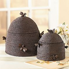 Beehive boxes - Ballard Designs.......if you wrapped thick jute around a cylinder box that was topped with an upside down bowl, then spray painted grey.