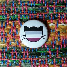 Hey, I found this really awesome Etsy listing at https://www.etsy.com/listing/185548216/asexual-flag-cat-pin-or-magnet