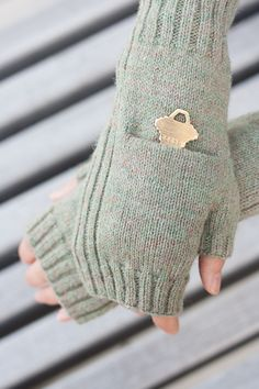 Free Knitting Pattern for Fingerless Pocket Mitts - Mitts with handy pockets to store your subway token, tissue, or any other small items to keep your hands free!. 2 sizes. Designed by Shannon Charles
