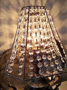stretched crystal prism chain between the shade frame. Lavender Hill Studio: Beautiful Vintage Silver Teapot Lamp With Prism Shade Teapot Lamp, Lamp Shade Frame, Old Lamp Shades, Recover Lamp Shades, Diy Crystals, Lampshades, Lampshade Chandelier, Diy Lampshade, Vintage Lamps