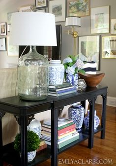 console table styling // lamp, wooden bowl, glass pentagon terrarium