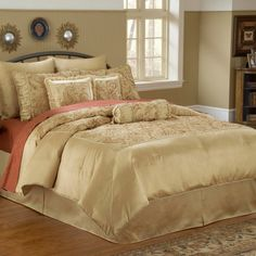 """""""You won't need silk pajamas when you can sleep in the silky softness of the Rothchild Comforter Set, a traditionally patterned ensemble that, in a champagne hue, glows with all the splendor of the morning sun itself...Champagne gold frames the large-scale, classic paisley print of the comforter, shams, and accent pillows, which are edged with fringe."""""""
