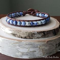 """C'mon guys, make them blue with envy when you show your friends this bracelet on your wrist. The whimsical blue and white tones of the sodalite stones will definitely make it a standout with whatever you wear. The hand-hammered copper button closure gives it a vintage feel. Specifications: Width: 3/8"""" Wrist fit:8 inch"""