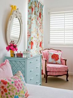 I love the colors! Curtains and chair are a perfect mix of pattern to me:)