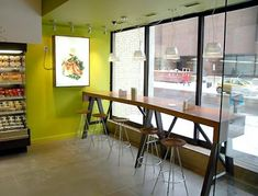 cafe seating looking outside - good bar idea for perimeter seating