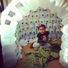 Day Nursery preschool student in igloo made of milk jugs